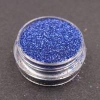 Glitter nail art blu.